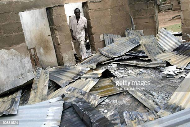 Pastor Mangmwos Tangshak walks through rubbles of Cocin Local Council Church 21 May 2004 burnt by rampaging Hausa Fulani herdsman at Sabon Gida in...