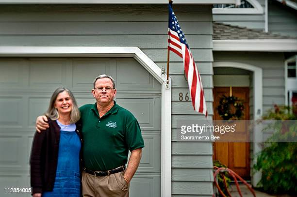 Pastor Michael Rodgers and his wife Bernadette stand in front of their home in Antelope California December 30 2009 Paster Rogers say a tax break is...
