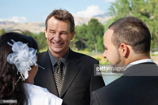 Pastor officiating an outdoor wedding
