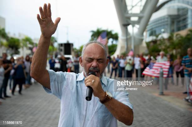 Pastor Pablo Vega from Orlando, FLorida prays during a religious vigil in front of the the Pedro Rosselló Convention Center on July 30, 2019 in San...