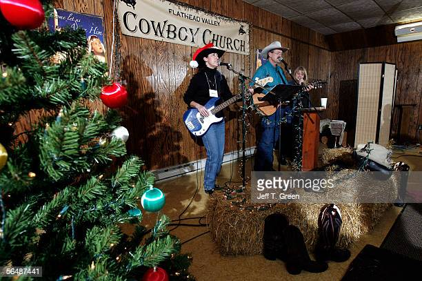 Pastor Paul Arends his wife Margie Arends and member Robyn Redpath lead the congregation of the Flathead Valley Cowboy Church in cowboy worship songs...
