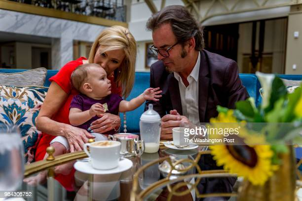 Pastor Paula White a Pentecostal Christian televangelist holds her granddaughter Asher Knight while having coffee with her husband Jonathan Cain in...