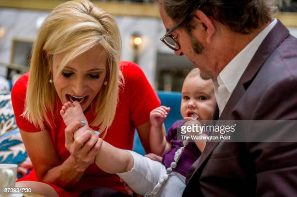 Pastor Paula White a Pentecostal Christian televangelist plays with her granddaughter Asher Knight while drinking coffee with her husband Jonathan...