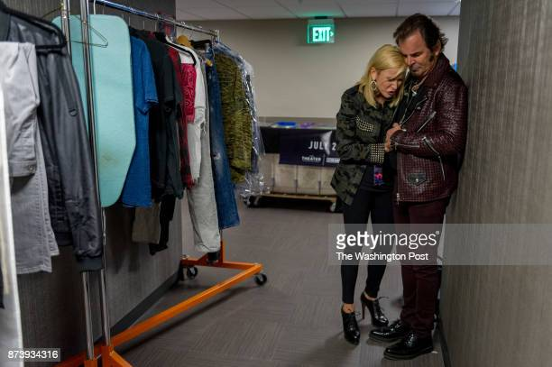 Pastor Paula White a Pentecostal Christian televangelist prays over her husband Jonathan Cain keyboard player for the band Journey before his band...