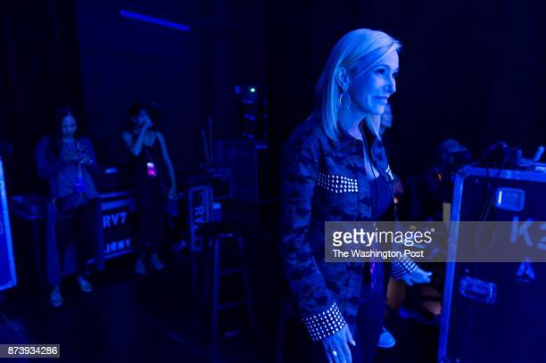 Pastor Paula White a Pentecostal Christian televangelist stands on the stage watching her husband Jonathan Cain play with his band Journey at the MGM...