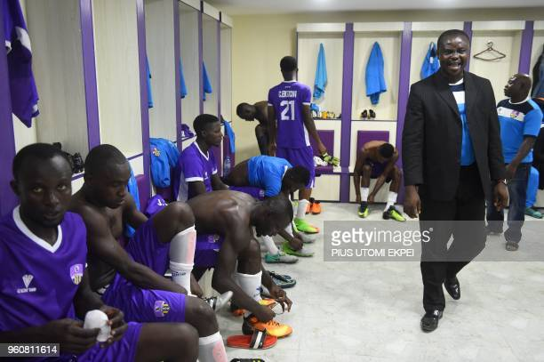 A pastor prays for the players of Mountain of Fire and Miracles Ministries football club in the changing room before a continental match at Agege...