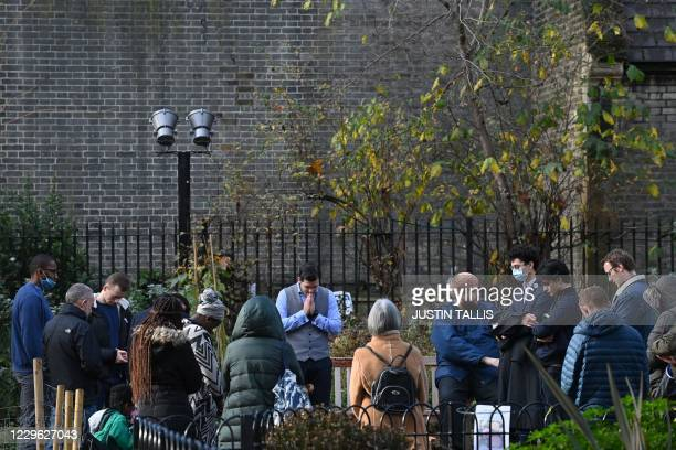 Pastor Regan King , of the Angel church in north London holds a service in near-by Myddelton Square Gardens on November 15 after coming to a...
