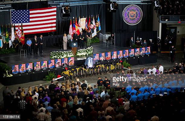 Pastor Ron Merrell leads a prayer during a memorial service at Tim's Toyota Center July 9 2013 in Prescott Valley Arizona The firefighters of the...