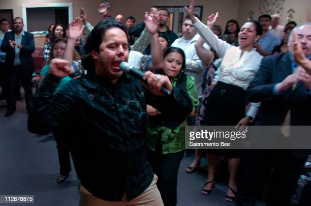 Pastor Samuel Rodriguez gets his congregation inspired during a bilingual sermon at the Centro Cristiano de Adoracion/Christian Worship Center April...