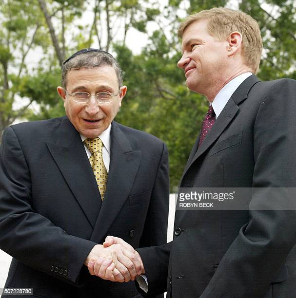 Pastor Ted Haggard president of the National Association of Evangelical Christians shakes hands with Rabbi Marvin Hier during a press conference at...