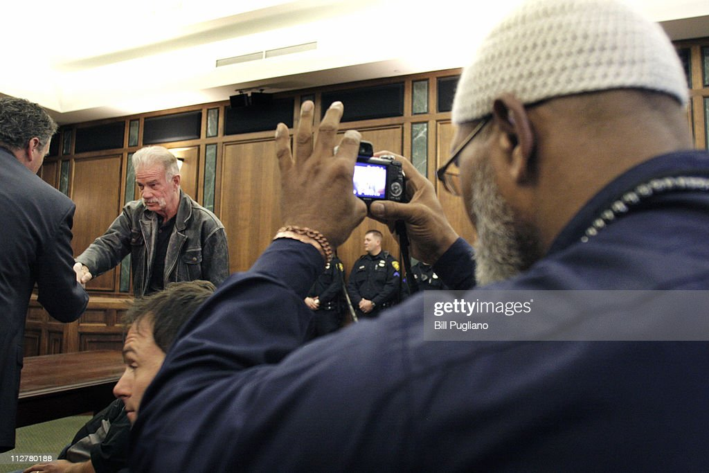 Pastor Terry Jones of Dove World Outreach Center (center, shaking hands) attends a hearing in 19th District Court April 21, 2011 in Dearborn, Michigan. The hearing was to discuss claims that his planned protest of radical islamists and sharia law at a Dearborn mosque on Good Friday, April 22nd could incite a riot, and to discuss the need for Jones to post a peace bond to cover police costs for providing security at the event.
