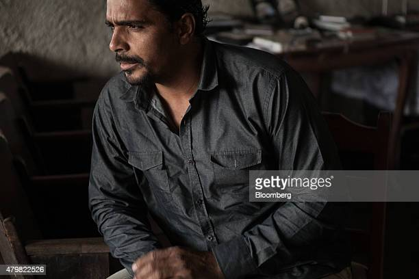 Pastor Vagner Gonzaga listens during an interview at his church in the Dilma Rousseff favela of Rio de Janeiro Brazil on Monday July 6 2015 As the...