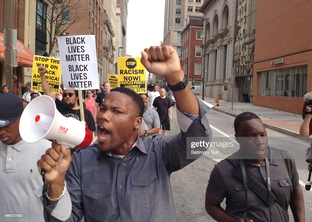 Pastor Westley West, Faith Empowered Ministries, leads protesters as they march towards Pratt Street and the Inner Harbor on Sept. 2, 2015 in Baltimore, Md. The first motions hearing in the Freddie Gray case will be held at 9:30 a.m. in Baltimore Circuit Court.