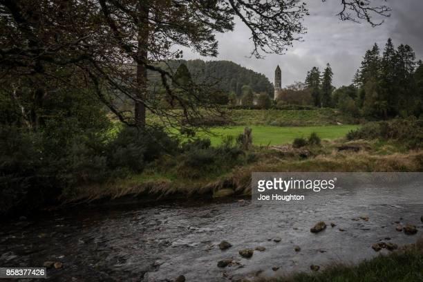 pastoral glendalough - irish round tower stock photos and pictures