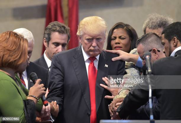 Pastors and attendees lay hands and pray over Republican presidential nominee Donald Trump during the Midwest Vision and Values Pastors and...