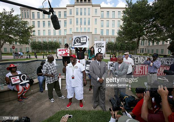 Pastors from the Daytona Beach Black Clergy Alliance speak to protesters and the media outside of the Seminole County Criminal Justice Center in...
