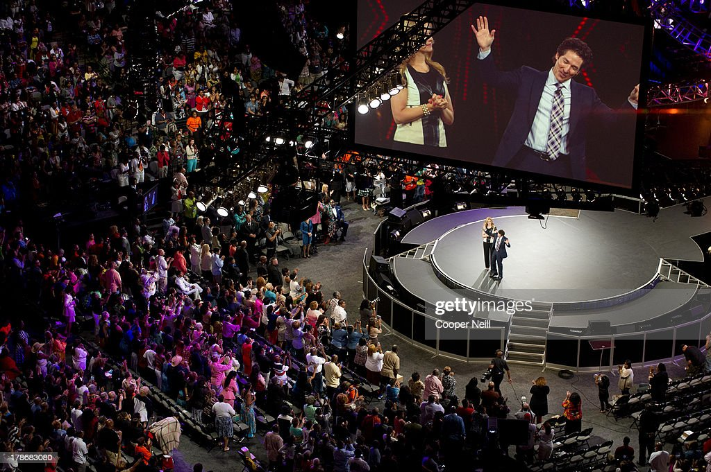 Pastors Victoria Osteen and Joel Osteen speak during MegaFest at the American Airlines Center on August 30, 2013 in Dallas, Texas.