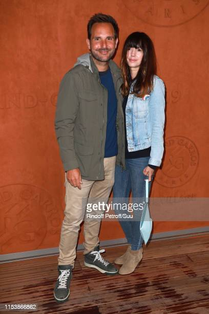Pastry Chef Christophe Michalak and his wife humorist Delphine McCarty attend the 2019 French Tennis Open Day Eleven at Roland Garros on June 05 2019...