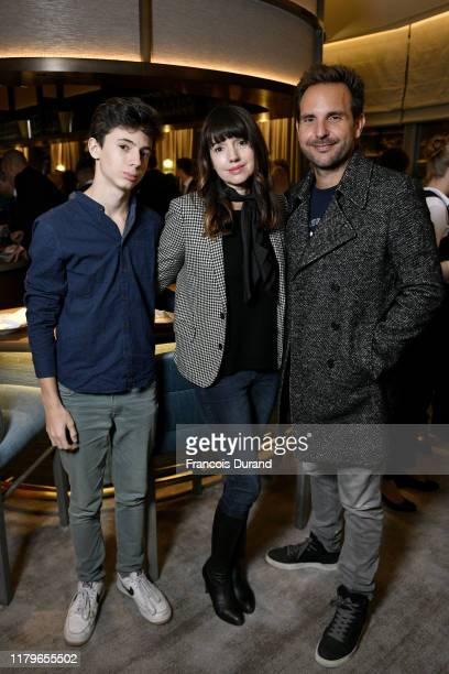Pastry Chef Christophe Michalak his wife Delphine McCarty and their son attend the Soirée D'Inauguration de PAVYLLON Yannick Alléno at Pavillon...