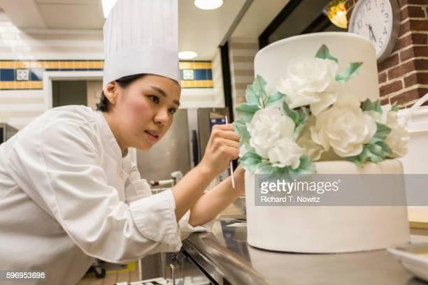 Pastry Chef decorates cake