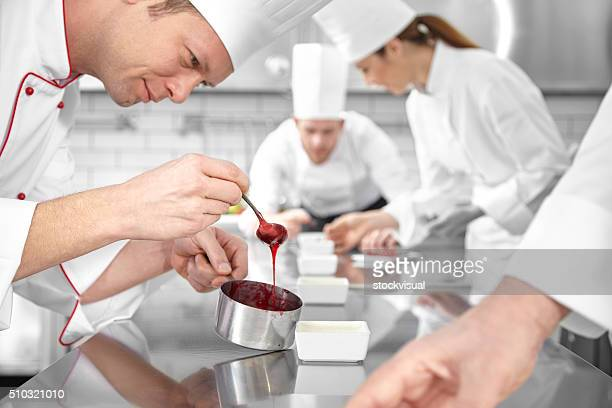 Pastry chef decorating desserts