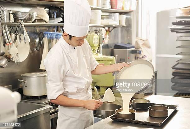 Pastry Chef making cake