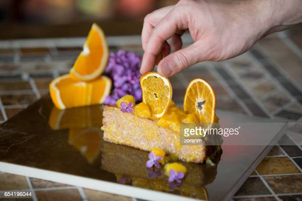 Pastry chef styling sponge cake
