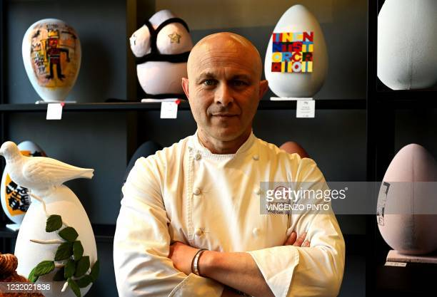 """Pastry chef Walter Musco poses for pictures with Easter chocolate eggs sculpted to pay tribute to different artists, in his pastry shop """"Pasticceria..."""