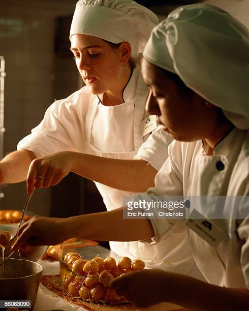 Pastry chefs preparing a croquembouche