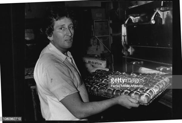 Pastry Cook Alan Rochester of Auburn takes a tray of 'Hot Cross Buns' from the oven April 19 1984