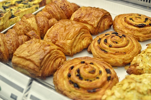 Pastry display: croissant, pain au chocolat, danish bread, almond croissant - gettyimageskorea