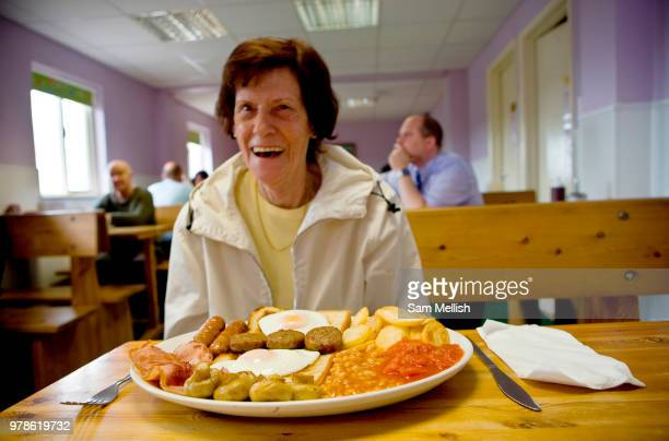 Pat a retired waitress sitting at a table with a huge full English breakfast at Smokey Joes transport cafe on 05th June 2008 in Blackwater in the...