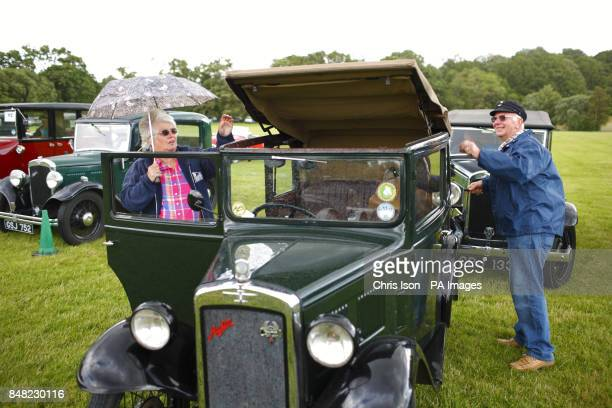 Pat and Glyn Llewellyn rush to put the roof up on their 1931 Austin Seven Tickford as a rain shower falls at the 50th Austin Seven rally at the...