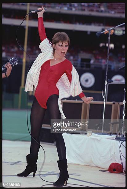 Pat Benatar performs at Veterans Stadium wearing a Phillies jersey