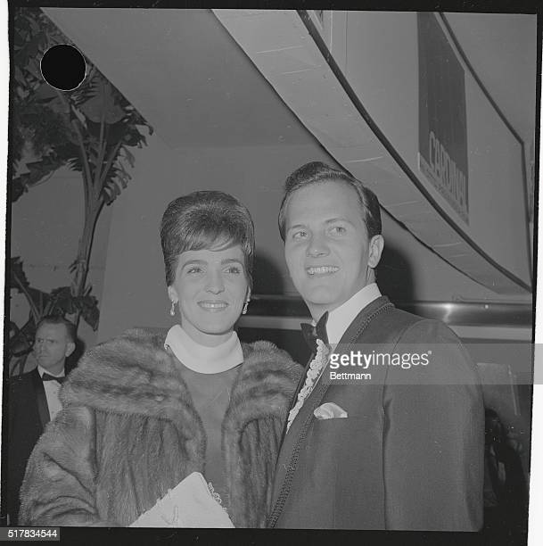 Pat Boone and his wife visit with Frankie Avalon and his wife at Paul Anka's February 22nd opening at the Ambassador's Cocoa nut Grove