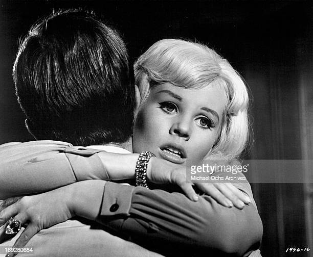 Pat Boone holds Pamela Austin in a scene from the film 'The Perils Of Pauline' 1967 Photo by Universal/Getty Images