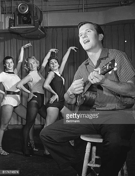Pat Boone runs through a routine with the dance group of ABC-TV's The Pat Boone Chevy Showroom.