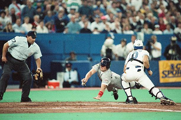 American league championship series toronto blue jays v pat borders of the toronto blue jays attempts to tag out chuck knoblauch of the minnesota sciox Choice Image