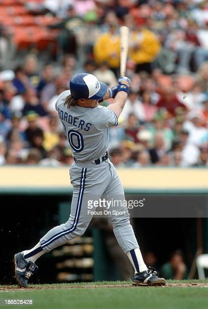 Pat Borders of the Toronto Blue Jays bats against the Oakland Athletics during an Major League Baseball game circa 1990 at the Oakland-Alameda County...