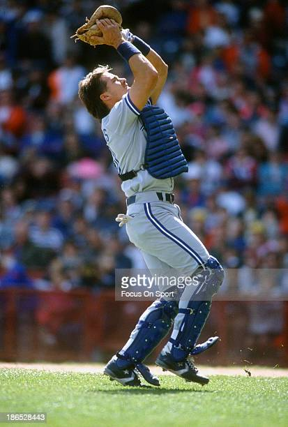 Pat Borders of the Toronto Blue Jays catches a popup against the Milwaukee Brewers during an Major League Baseball game circa 1989 at Milwaukee...