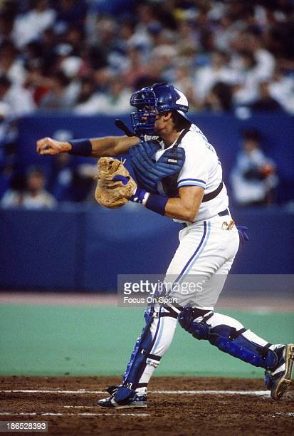 Pat Borders of the Toronto Blue Jays throws down to second base during an Major League Baseball game circa 1990 at Exhibition Stadium in Toronto,...