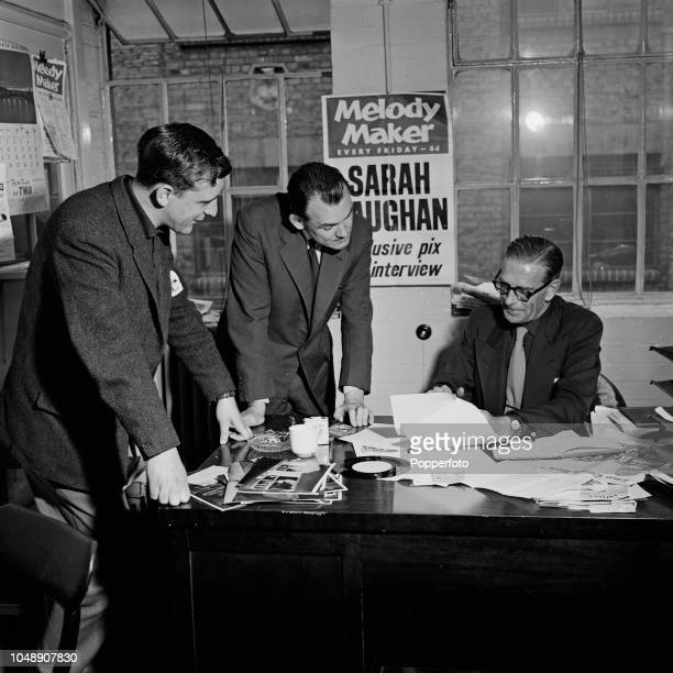Pat Brand editor of the music magazine Melody Maker pictured at his desk with journalists Tony Brown and Jack Hutton in the Melody Maker office in...