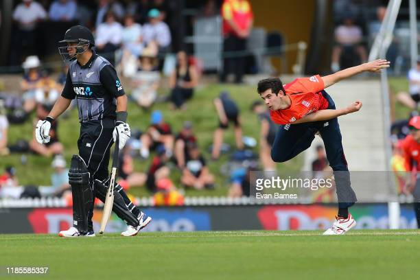 Pat Brown in action as Ross Taylor watches on during game three of the Twenty20 International series between New Zealand and England at Saxton Field...