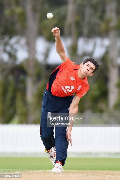 Pat Brown of England bowls during the Twenty20 International Tour match between the New Zealand XI and England on October 27 2019 in Lincoln New...