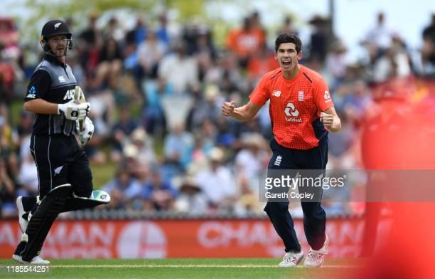 Pat Brown of England celebrates dismissing Martin Guptill of New Zealand during game three of the Twenty20 International series between New Zealand...
