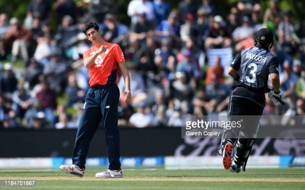 Pat Brown of England celebrates dismissing Ross Taylor of New Zealand during game one of the Twenty20 International series between New Zealand and...