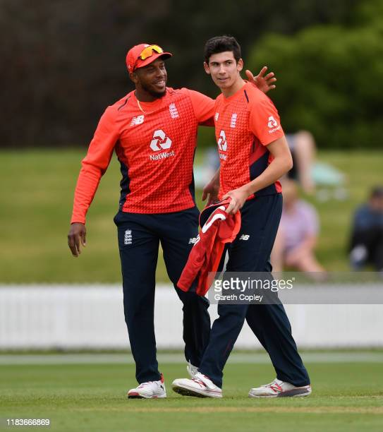 Pat Brown of England celebrates with Chris Jordan after dismissing Christian Leopard of New Zealand XI during the tour match between New Zealand XI...