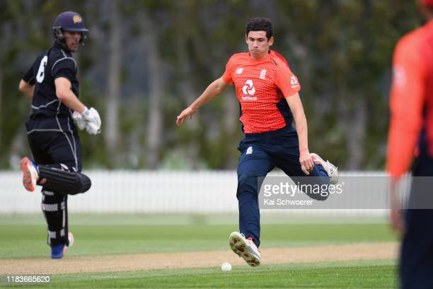 Pat Brown of England fields the ball off his own bowling during the Twenty20 International Tour match between the New Zealand XI and England on...