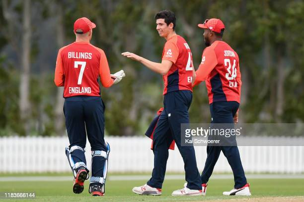 Pat Brown of England is congratulated by team mates after dismissing Christian Leopard of New Zealand XI during the Twenty20 International Tour match...