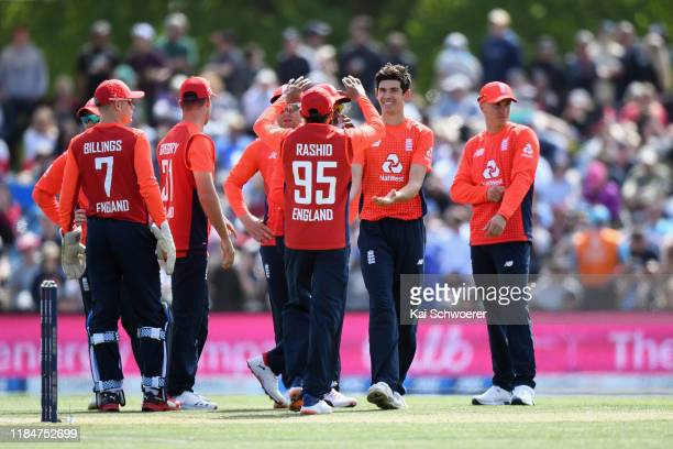 Pat Brown of England is congratulated by team mates after dismissing Ross Taylor of New Zealand during game one of the Twenty20 International series...